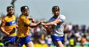 12 May 2019; Pauric Mahony of Waterford is hooked by Tony Kelly of Clare during the Munster GAA Hurling Senior Championship Round 1 match between Waterford and Clare at Walsh Park in Waterford. Photo by Ray McManus/Sportsfile