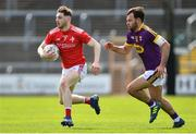 12 May 2019; John Clutterbuck of Louth in action against Conor Devitt of Wexford during the Leinster GAA Football Senior Championship Round 1 match between Wexford and Louth at Innovate Wexford Park in Wexford.   Photo by Matt Browne/Sportsfile