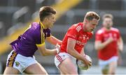 12 May 2019; Jim McEneaney of Louth in action against Eoin Porter of Wexford during the Leinster GAA Football Senior Championship Round 1 match between Wexford and Louth at Innovate Wexford Park in Wexford. Photo by Matt Browne/Sportsfile