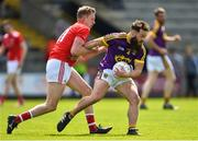12 May 2019; Conor Carty of Wexford in action against Jim McEneaney of Louth during the Leinster GAA Football Senior Championship Round 1 match between Wexford and Louth at Innovate Wexford Park in Wexford. Photo by Matt Browne/Sportsfile