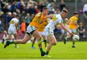 12 May 2019; Peter Cunningham of Offaly in action against Bryan Menton of Meath during the Leinster GAA Football Senior Championship Round 1 match between Meath and Offaly at Páirc Tailteann, Navan in Meath. Photo by Brendan Moran/Sportsfile