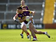 12 May 2019; Glen Malone of Wexford in action against Conal McKeever of Louth during the Leinster GAA Football Senior Championship Round 1 match between Wexford and Louth at Innovate Wexford Park in Wexford. Photo by Matt Browne/Sportsfile