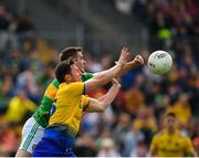12 May 2019; Diarmuid Murtagh of Roscommon in action against Paddy Maguire of Leitrim during the Connacht GAA Football Senior Championship Quarter-Final match between Roscommon and Leitrim at Dr Hyde Park in Roscommon. Photo by Seb Daly/Sportsfile