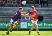 12 May 2019; Sam Mulroy of  Louth in action against Gavin Sheehan of Wexford during the Leinster GAA Football Senior Championship Round 1 match between Wexford and Louth at Innovate Wexford Park in Wexford. Photo by Matt Browne/Sportsfile
