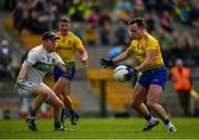 12 May 2019; Niall Kilroy of Roscommon in action against Cathal McCrann of Leitrim during the Connacht GAA Football Senior Championship Quarter-Final match between Roscommon and Leitrim at Dr Hyde Park in Roscommon. Photo by Seb Daly/Sportsfile