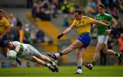 12 May 2019; Niall Kilroy of Roscommon shoots to score his side's third goal of the game past Cathal McCrann of Leitrim during the Connacht GAA Football Senior Championship Quarter-Final match between Roscommon and Leitrim at Dr Hyde Park in Roscommon. Photo by Seb Daly/Sportsfile