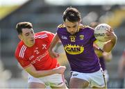 12 May 2019; Conor Devitt of Wexford in action against Fergal Donohoe of Louth during the Leinster GAA Football Senior Championship Round 1 match between Wexford and Louth at Innovate Wexford Park in Wexford.   Photo by Matt Browne/Sportsfile