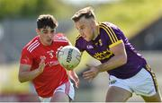 12 May 2019; Jonathan Bealin of Wexford in action against Emmet Carolan of Louth during the Leinster GAA Football Senior Championship Round 1 match between Wexford and Louth at Innovate Wexford Park in Wexford.   Photo by Matt Browne/Sportsfile