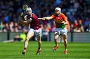 12 May 2019; Cathal Mannion of Galway scores a point under pressure from Jack Kavanagh of Carlow during the Leinster GAA Hurling Senior Championship Round 1 match between Galway and Carlow at Pearse Stadium in Galway. Photo by Piaras Ó Mídheach/Sportsfile
