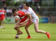 12 May 2019; Shane McGuigan of Derry in action against Colm Cavanagh of Tyrone during the Ulster GAA Football Senior Championship preliminary round match betweenTyrone and Derry at Healy Park, Omagh in Tyrone. Photo by Oliver McVeigh/Sportsfile