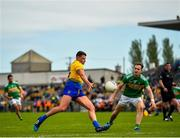 12 May 2019; Conor Cox of Roscommon in action against Micheal McWeeney of Leitrim during the Connacht GAA Football Senior Championship Quarter-Final match between Roscommon and Leitrim at Dr Hyde Park in Roscommon. Photo by Seb Daly/Sportsfile