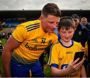 12 May 2019; Conor Cox of Roscommon poses for a photograph with a young supporter following the Connacht GAA Football Senior Championship Quarter-Final match between Roscommon and Leitrim at Dr Hyde Park in Roscommon. Photo by Seb Daly/Sportsfile