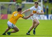 12 May 2019; Johnny Moloney of Offaly evades the tackle of Donal Keogan of Meath during the Leinster GAA Football Senior Championship Round 1 match between Meath and Offaly at Páirc Tailteann, Navan in Meath. Photo by Brendan Moran/Sportsfile