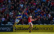 12 May 2019; Patrick Horgan of Cork shoots to score his side's seventeenth point despite the efforts of Cathal Barrett of Tipperary during the Munster GAA Hurling Senior Championship Round 1 match between Cork and Tipperary at Pairc Ui Chaoimh in Cork. Photo by Diarmuid Greene/Sportsfile