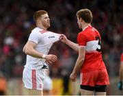 12 May 2019; Cathal McShane of Tyrone and Brendan Rogers of Derry react during the Ulster GAA Football Senior Championship preliminary round match between Tyrone and Derry at Healy Park, Omagh in Tyrone. Photo by Oliver McVeigh/Sportsfile