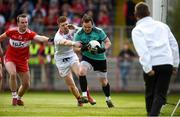 12 May 2019; Thomas Mallon of Derry under pressure from Cathal McShane of Tyrone during the Ulster GAA Football Senior Championship preliminary round match between Tyrone and Derry at Healy Park, Omagh in Tyrone. Photo by Oliver McVeigh/Sportsfile