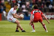 12 May 2019; Richard Donnelly of Tyrone in action against Jason Rocks of Derry during the Ulster GAA Football Senior Championship preliminary round match between Tyrone and Derry at Healy Park, Omagh in Tyrone. Photo by Oliver McVeigh/Sportsfile