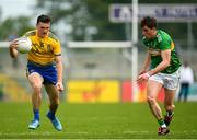 12 May 2019; Hubert Darcy of Roscommon in action against Raymond Mulvey of Leitrim during the Connacht GAA Football Senior Championship Quarter-Final match between Roscommon and Leitrim at Dr Hyde Park in Roscommon. Photo by Seb Daly/Sportsfile