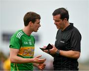12 May 2019; Evan Sweeney of Leitrim is spoken to by referee Sean Hurson during the Connacht GAA Football Senior Championship Quarter-Final match between Roscommon and Leitrim at Dr Hyde Park in Roscommon. Photo by Seb Daly/Sportsfile