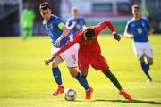 13 May 2019; Pedro Brazão of Portugal in action against Simone Panada of Italy during the 2019 UEFA European Under-17 Championships quarter-final match between Italy and Portugal at Tolka Park in Dublin. Photo by Stephen McCarthy/Sportsfile