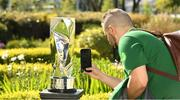 13 May 2019; Adam Thompson of the FAI photographs the new trophy at the Unite the Union Champions Cup Launch in the Grand Hotel in Malahide, Dublin. Photo by Ray McManus/Sportsfile
