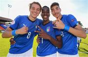 13 May 2019; Italy players, from left, Nikola Sekulov, Franco Tongya of Italy, and Alessandro Pio Riccio celebrate following the 2019 UEFA European Under-17 Championships Quarter-Final match between Italy and Portugal at Tolka Park in Dublin. Photo by Stephen McCarthy/Sportsfile