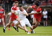 12 May 2019; Matthew Donnelly of Tyrone in action against Christopher McKaigue of Derry during the Ulster GAA Football Senior Championship preliminary round match betweenTyrone and Derry at Healy Park, Omagh in Tyrone. Photo by Oliver McVeigh/Sportsfile
