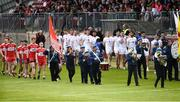 12 May 2019; The Derry and Tyrone teams during the pre-match parade before the Ulster GAA Football Senior Championship preliminary round match betweenTyrone and Derry at Healy Park, Omagh in Tyrone. Photo by Oliver McVeigh/Sportsfile
