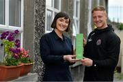 15 May 2019; James Talbot of Bohemians is presented with his SSE Airtricity/SWAI Player of the Month award for April by SSE Airtricity Digital Marketing Lead Ruth Ryan at St Gabriel's National School in Stoneybatter, Dublin. Photo by Brendan Moran/Sportsfile