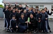 15 May 2019; James Talbot of Bohemians is presented with his SSE Airtricity/SWAI Player of the Month award for April by SSE Airtricity Digital Marketing Lead Ruth Ryan in the company of students from 5th and 6th class in St Gabriel's National School in Stoneybatter, Dublin. Photo by Brendan Moran/Sportsfile