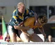 21 October 2003; Kieran Burke, Western Australia, in action against Ireland's Shane Ryan. Foster's International Rules, Preparation match, Western Australia v Ireland, Swan Districts Football Club, Bassendean Oval, Bassendean, Perth, Western Australia. Picture credit; Ray McManus / SPORTSFILE *EDI*