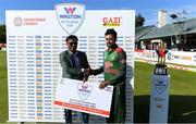 15 May 2019; Uday Hakim, of Walton, presents Abu jahid chy rahi of Bangladesh with his player of the match award after the One Day International match between Ireland and Bangladesh at Clontarf Cricket Club, Clontarf in Dublin.     Photo by Piaras Ó Mídheach/Sportsfile