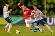 13 May 2019; György Komáromi of Hungary in action against Alvaro Carrillo Alacid of Spain during the 2019 UEFA European Under-17 Championships Quarter-Final match between Hungary and Spain at UCD Bowl in Dublin. Photo by Ben McShane/Sportsfile