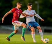 13 May 2019; András Németh of Hungary in action against Javier López Carballo of Spain during the 2019 UEFA European Under-17 Championships Quarter-Final match between Hungary and Spain at UCD Bowl in Dublin. Photo by Ben McShane/Sportsfile