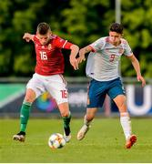 13 May 2019; Gergo Ominger of Hungary in action against Jordi Escobar Fernández of Spain during the 2019 UEFA European Under-17 Championships Quarter-Final match between Hungary and Spain at UCD Bowl in Dublin. Photo by Ben McShane/Sportsfile