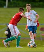13 May 2019; Robert Navarro Muñoz of Spain in action against Patrick Posztobányi of Hungary during the 2019 UEFA European Under-17 Championships Quarter-Final match between Hungary and Spain at UCD Bowl in Dublin. Photo by Ben McShane/Sportsfile