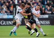 17 May 2019; Adam Hasting of Glasgow, right, is tackled by Jordi Murphy, left, and John Cooney of Ulster during the Guinness PRO14 Semi-Final match between Glasgow Warriors and Ulster at Scotstoun Stadium in Glasgow, Scotland. Photo by Ross Parker/Sportsfile