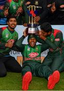 15 May 2019; Bangladesh players, including Mushfiqur Rahim, centre, celebrate with the Tri-Series Trophy following the One-Day International Tri-Series Final match between West Indies and Bangladesh at Malahide Cricket Ground, Malahide, Dublin. Photo by Sam Barnes/Sportsfile