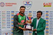 15 May 2019; Mashrafe Mortaza of Bangladesh is presented with the Tri-Series Trophy by Uday Hakim, Executive Director, Walton Group, following the One-Day International Tri-Series Final match between West Indies and Bangladesh at Malahide Cricket Ground, Malahide, Dublin. Photo by Sam Barnes/Sportsfile