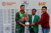 15 May 2019; Mashrafe Mortaza of Bangladesh is presented with the Tri-Series Trophy by Uday Hakim, Executive Director, Walton Group, and Moinul Haque Chowdury, CEO, Total Sports Marketing, following the One-Day International Tri-Series Final match between West Indies and Bangladesh at Malahide Cricket Ground, Malahide, Dublin. Photo by Sam Barnes/Sportsfile