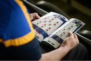 12 May 2019; A Tipperary supporter reads their match programme prior to the Munster GAA Hurling Senior Championship Round 1 match between Cork and Tipperary at Pairc Ui Chaoimh in Cork. Photo by Diarmuid Greene/Sportsfile