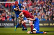 18 May 2019; Tadhg Beirne of Munster is tackled by Josh van der Flier, left, and Robbie Henshaw of Leinster during the Guinness PRO14 semi-final match between Leinster and Munster at the RDS Arena in Dublin. Photo by Harry Murphy/Sportsfile