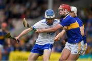 19 May 2019; Cian Rellis of Waterford in action against Conor Ryan of Tipperary during the Electric Ireland Munster Minor Hurling Championship match between Tipperary and Waterford at Semple Stadium, Thurles in Tipperary. Photo by Ray McManus/Sportsfile