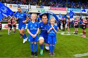 18 May 2019; Leinster captain Rhys Ruddock with matchday mascots 8 year old Hattie Farrell and 7 year old Annie Kerin at the Guinness PRO14 semi-final match between Leinster and Munster at the RDS Arena in Dublin. Photo by Ramsey Cardy/Sportsfile