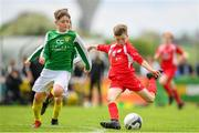 19 May 2019; Cathal O'Sullivan of Cork in action against Oisin McHugh of Donegal during the Under 12 SFAI Subway Championship Final match between Donegal and Cork at Mullingar Athletic in Gainstown, Westmeath. Photo by Ramsey Cardy/Sportsfile