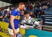 19 May 2019; Jason Forde of Tipperary poses for a selfie with a supporter after the Munster GAA Hurling Senior Championship Round 2 match between Tipperary and Waterford at Semple Stadium, Thurles in Tipperary. Photo by Ray McManus/Sportsfile