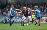 19 May 2019; Simon Donohoe of Wexford in action against Danny Sutcliffe, left, and Fergal Whitely of Dublin during the Leinster GAA Hurling Senior Championship Round 2 match between Dublin and Wexford at Parnell Park in Dublin. Photo by Daire Brennan/Sportsfile