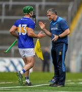 19 May 2019; Tipperary manager Liam Sheedy congratulates John O'Dwyer as he leaves the field after being substituted late in the Munster GAA Hurling Senior Championship Round 2 match between Tipperary and Waterford at Semple Stadium, Thurles in Tipperary. Photo by Ray McManus/Sportsfile