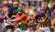 19 May 2019; David English of Carlow clears despite the attention of Bill Sheehan of Kilkenny during the Leinster GAA Hurling Senior Championship Round 2 match between Carlow and Kilkenny at Netwatch Cullen Park in Carlow. Photo by Ben McShane/Sportsfile