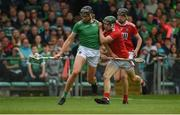 19 May 2019; Gearóid Hegarty of Limerick in action against Mark Coleman and Robert Downey of Cork during the Munster GAA Hurling Senior Championship Round 2 match between Limerick and Cork at the LIT Gaelic Grounds in Limerick. Photo by Diarmuid Greene/Sportsfile